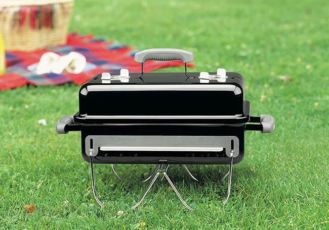 Weber Go-Anywhere Charcoal Grill Outdoors in Grass