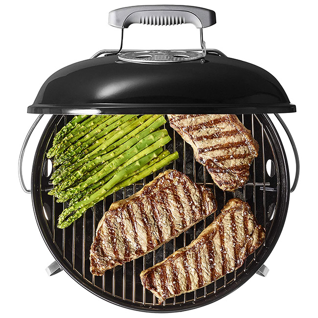 Meat and vegetables being grilled on the Weber Smokey Joe Premium Charcoal Grill